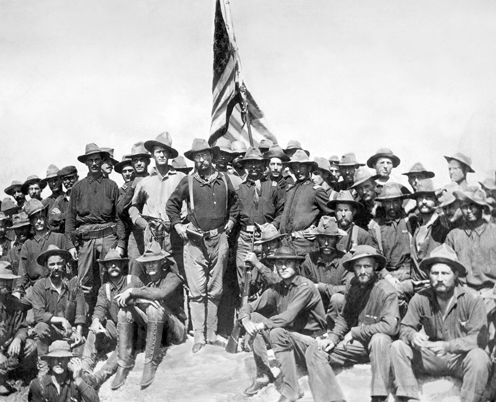 Future President Theodore Roosevelt with his Rough Riders on San Juan Hill.